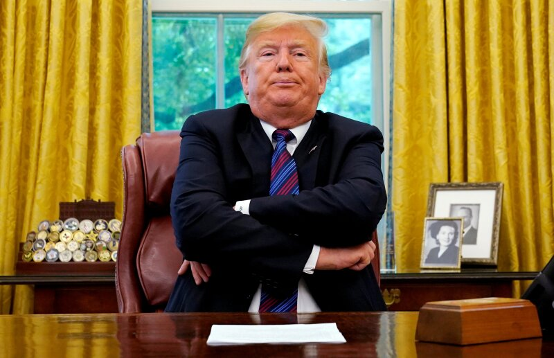 FILE PHOTO:    President Trump sits behind his desk as he makes announcement about a bilateral trade deal with Mexico at the White House in Washington