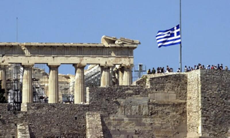 Los tenedores de bonos griegos acordaron aceptar un recorte del 21% de su valor en julio como parte de un rescate de la UE y el FMI. (Foto: AP)