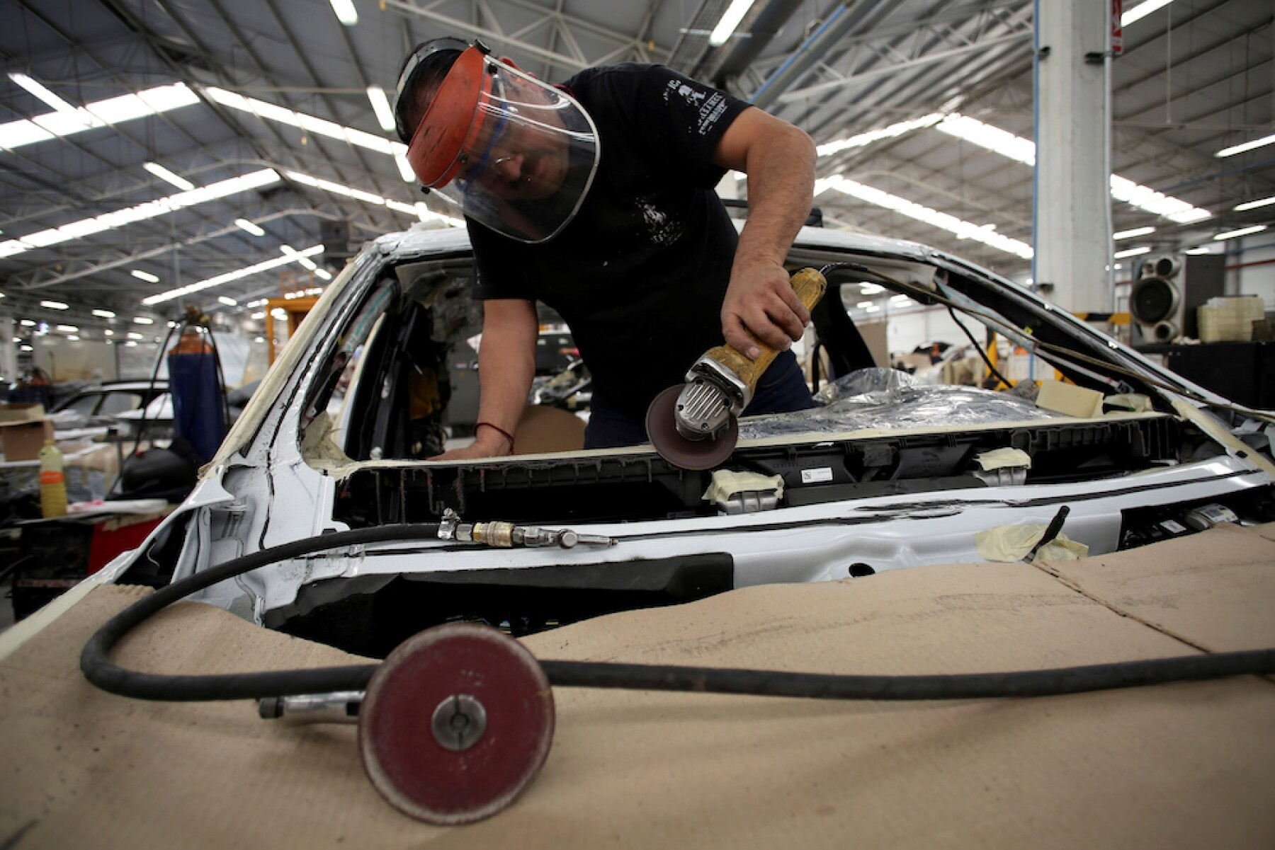 FILE PHOTO: An employee works on a dismantled chasis of a vehicle before armoring it at the garage of Blindajes EPEL company in Mexico City