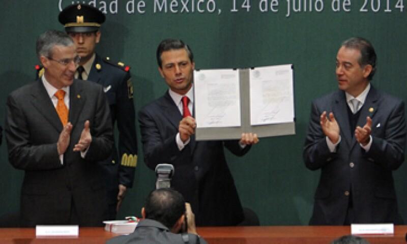 El presidente Enrique Peña Nieto promulgó este lunes las leyes en Palacio Nacional. (Foto: Notimex)