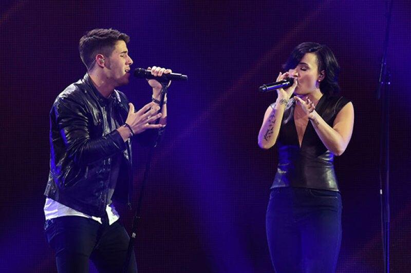 La estrella de American Idol publica que no hay problemas entre ellos después de que Demi Lovato lo sustituyera por Nick Jonas para abrir sus próximos conciertos.