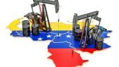 Venezuela map with oil barrels and pumpjacks. Oil production concept. 3D rendering