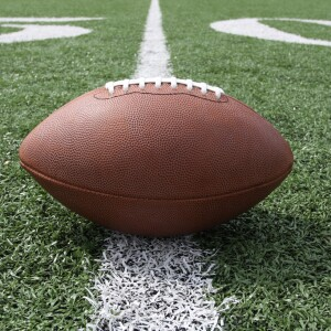 Ground level view of a football on the fifty yard line