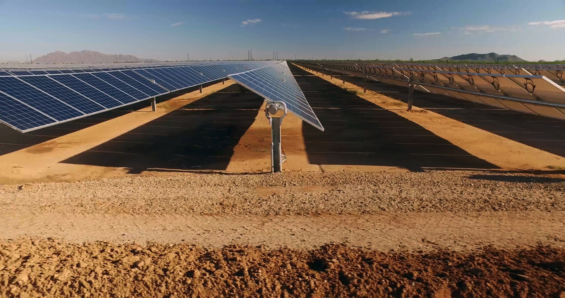 close up of solar power panels in desert