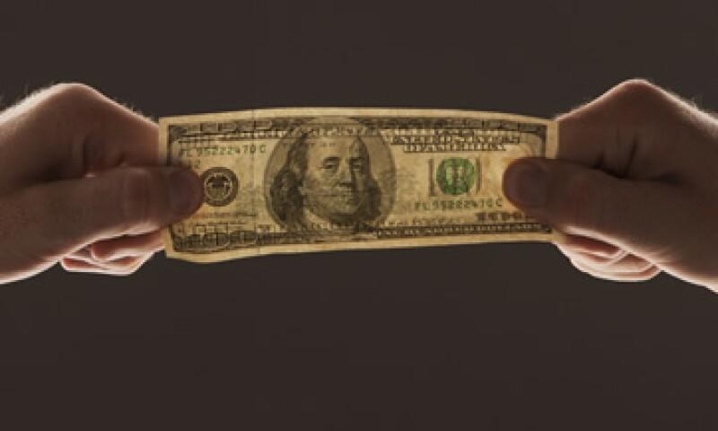 El experto sugiere que la política de tasas de interés bajas hasta 2004 costó 7,500 dólares a los prestamistas tras la crisis. (Foto: Photos to Go)