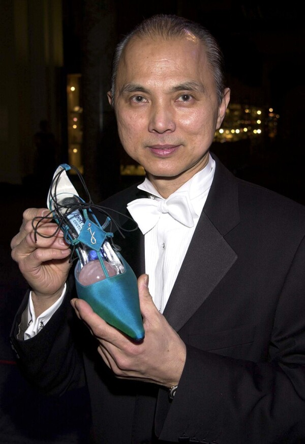 JIMMY CHOO AND SHOE WITH DIAMONDS AT THE JIMMY CHOO GALA FOR TOMMY CAMPAIGN AT THE VICTORIA AND ALBERT MUSEUM LONDON, BRITAIN - 08/03/01