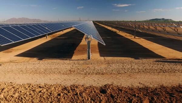 close up of solar power panels in desert