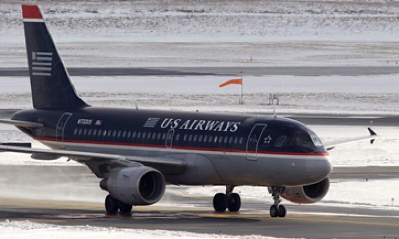 Ejecutivos de US Airways han buscado en forma activa un acuerdo con American Airlines. (Foto: AP)