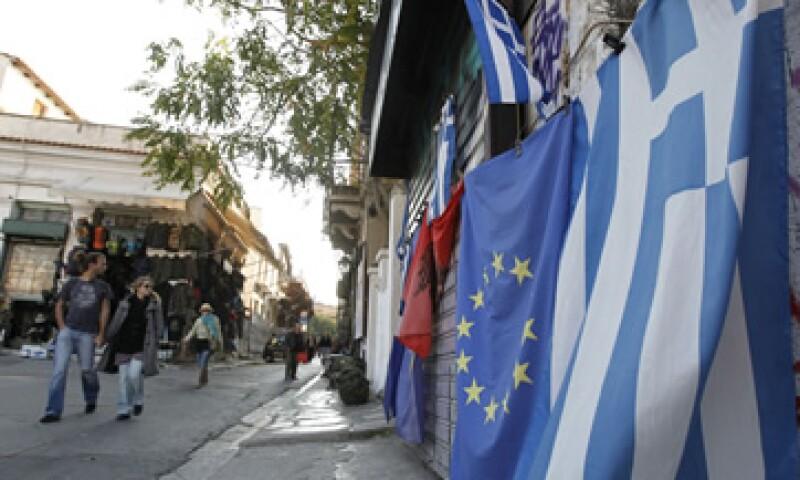 La confianza de inversionistas en que a la postre se logrará un acuerdo, hizo subir las acciones bursátiles y al euro.  (Foto: AP)