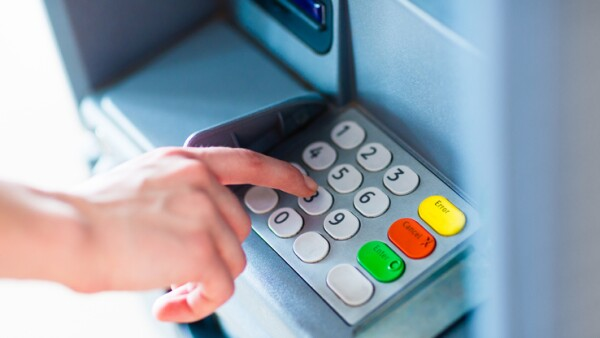 A person withdrawing money from a atm machine