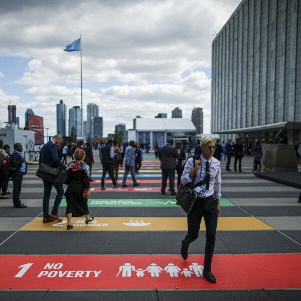People walk outside on the grounds of the United Nations headquarters during the 74th session of the United Nations General Assembly in New York City, New York