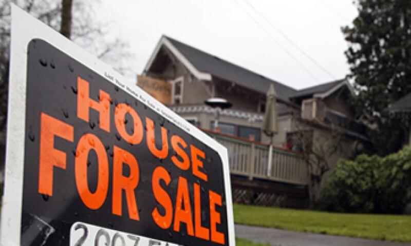 Los ejecutivos parecieron darse cuenta de que el modelo de S&P para calificar los bonos hipotecarios era demasiado indulgente. (Foto: AP)