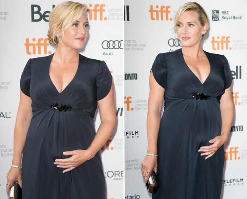 La actriz británica de 37 años está más que feliz por su embarazo. Lució espectacular durante la premiere de su película `Labor Day´.