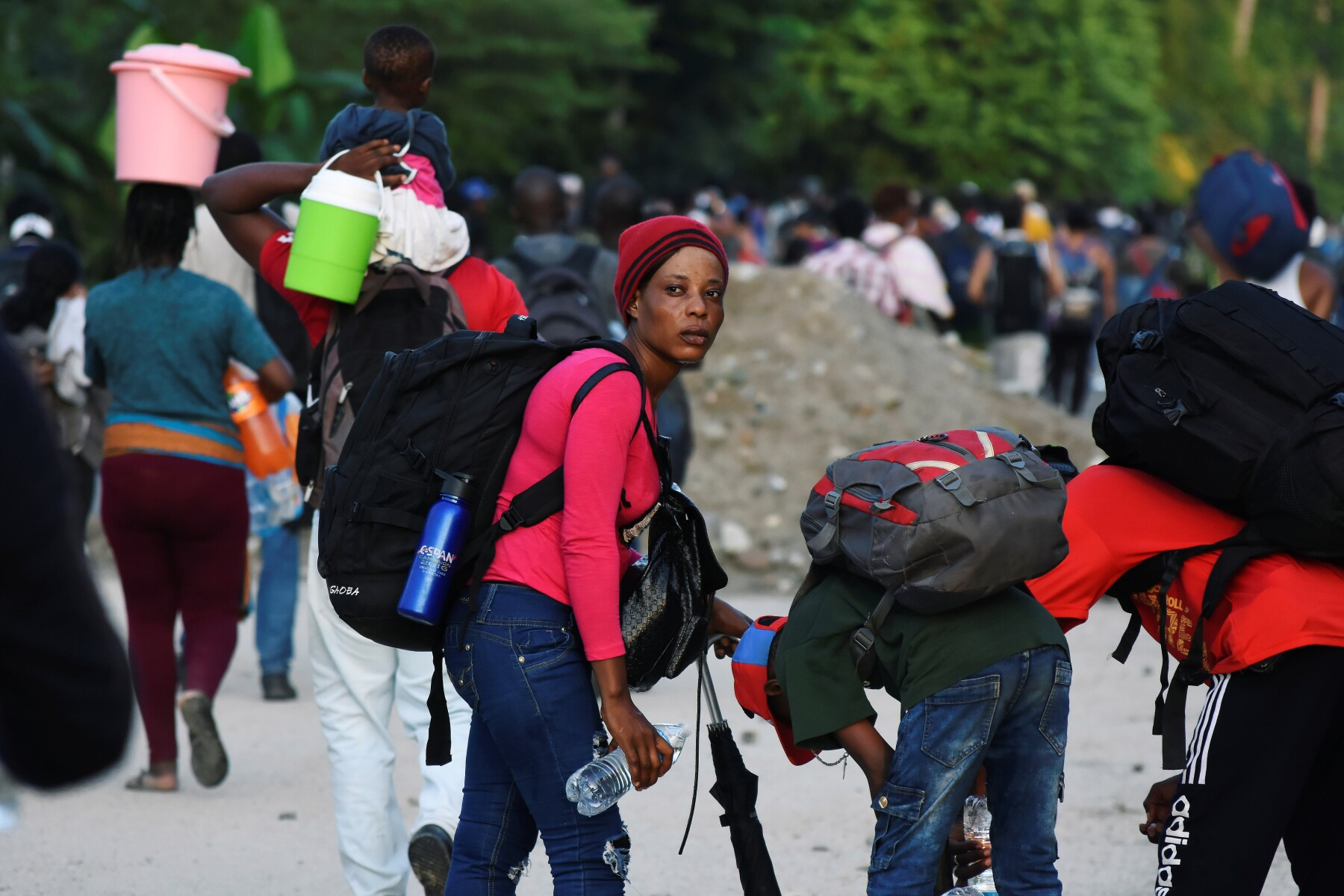 Migrants walk along a road in a caravan towards the United States, in Tapachula