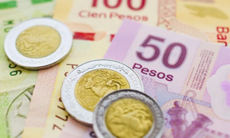 La divisa local reportó un retroceso de 0.35%, según el precio de refernecia de Banxico. (Foto: Getty Images)
