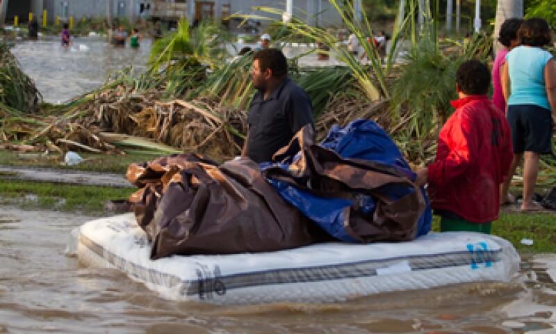 Tres de los 10 estados que registran inundaciones recibirán los primeros recursos del Fonden. (Foto: Notimex)