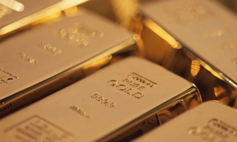 El oro ha caído ante preocupaciones de que la era de dinero barato de la Fed está culminando ante una mejora en las cifras económicas de EU. (Foto: Getty Images)
