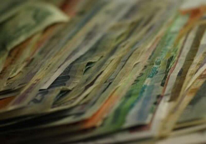 La rebaja puede inhibir los flujos de divisas al mercado cambiario mexicano(Foto: Jupiter Images)