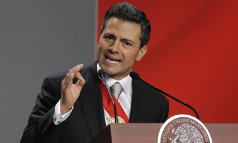 El presidente Enrique Peña Nieto, dijo que ratificará a los funcionarios propuestos por el Gobierno capitalino para la PGR.  (Foto: AP)