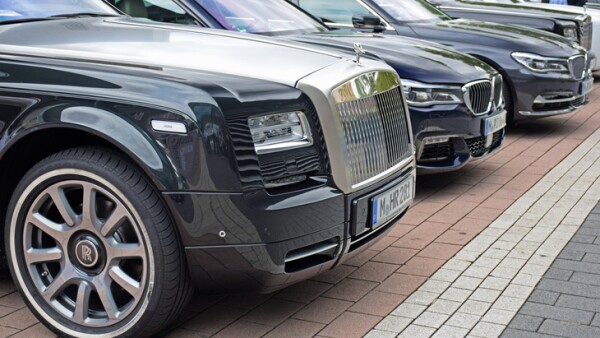 Rolls-Royce and BMW vehicles on the parking