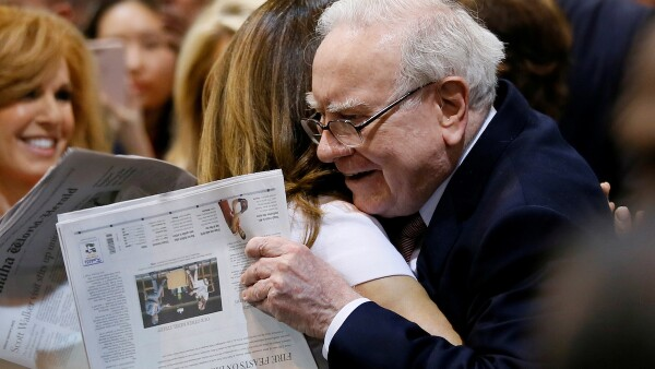 FILE PHOTO: Berkshire Hathaway chairman and CEO Warren Buffett hugs former model Kathy Ireland before the Berkshire's annual meeting in Omaha