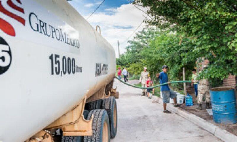 GMéxico afirma que ha entregado más de 13 millones de litros de agua para uso humano y doméstico. (Foto: Notimex)