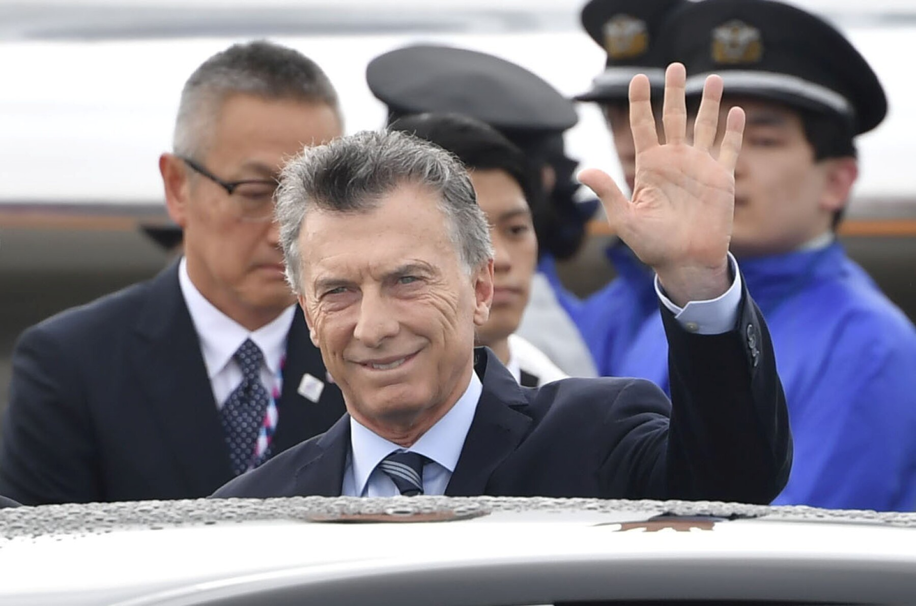 Argentine President Mauricio Macri waves upon his arrival at Kansai international airport ahead of the start of G20 leaders summit in Izumisano, Osaka prefecture, Japan
