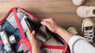 Empty wallet in the hand man on Travel accessories  background