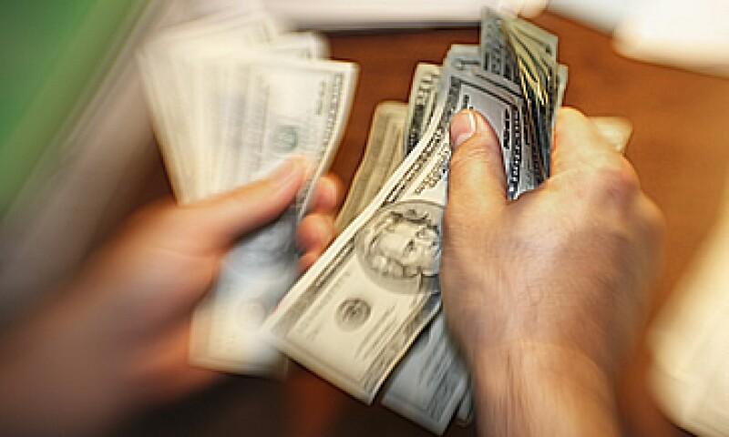 Banco Base estima que el tipo de cambio podría oscilar este jueves en un rango de entre 12.73 y 12.82 pesos por dólar. (Foto: Getty Images)
