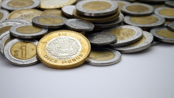 Ten Mexican Peso Coin Spot Lit Among Other Pesos dinero economia monedas divisas