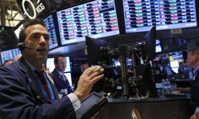 Los mercados esperan una reducción de 10,000 mdd del programa de compras de bonos. (Foto: Reuters)