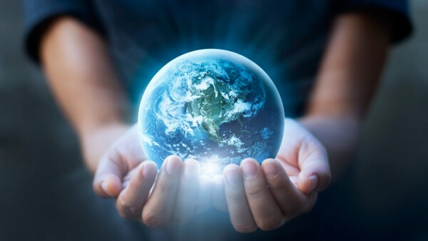 Earth day, Human hands holding blue earth, save earth concept. Elements of this image furnished by NASA