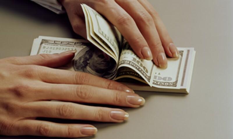 Grupo Financiero Ve Por Más estima que el tipo de cambio podría oscilar este jueves entre 12.97 y 13.04 pesos. (Foto: Getty Images)