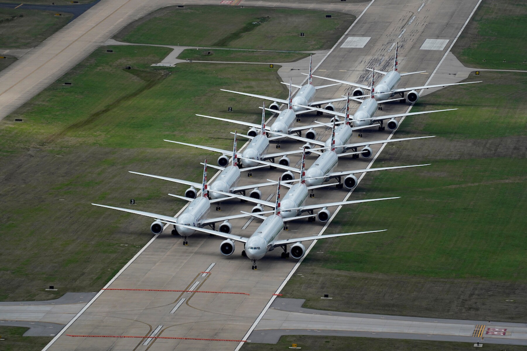 FILE PHOTO: American Airlines passenger planes crowd a runway in Tulsa