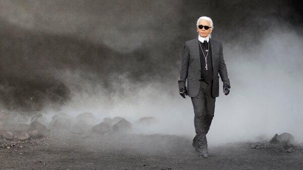 FILE PHOTO - German designer Lagerfeld appears at the end of his Fall-Winter 2011/2012 women's ready-to-wear fashion collection show for French fashion house Chanel during Paris Fashion Week
