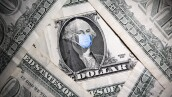 George Washington is seen with printed medical mask on the one dollar banknote in this illustration taken