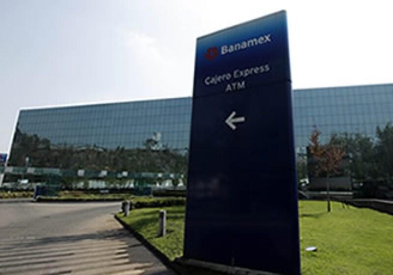 Los bancos registraron menores ganancias debido a una desaceleración en el crecimiento de su margen financiero. (Foto: AP)