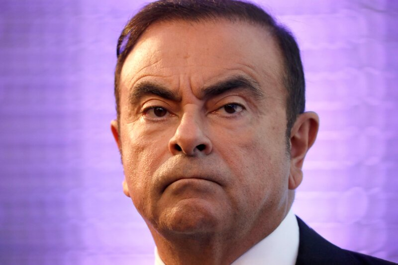 FILE PHOTO - Carlos Ghosn, Chairman and CEO of the Renault-Nissan Alliance, attends a news conference to unveil Renault's next mid-term strategic plan in Paris