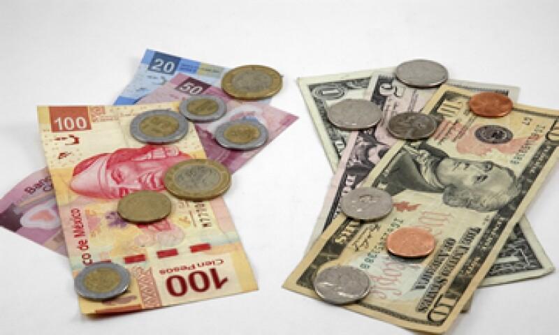 Un peso más débil haría que algunas empresas mexicanas reciban más pesos por cada dólar que vendan.  (Foto: iStock by Getty Images.)