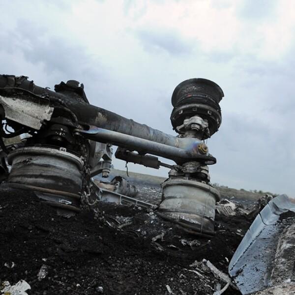 Los restos quemados del avión de Malaysia Airlines