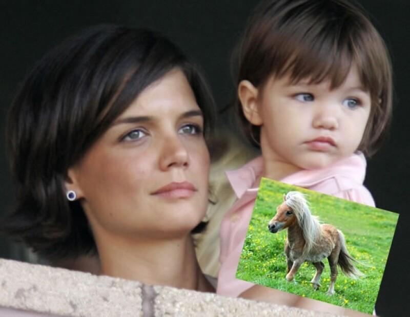 Katie Holmes y Tom Cruise hacen lo que sea con tal de complacer a su pequeña Suri. Aquí cuando tenía un año.