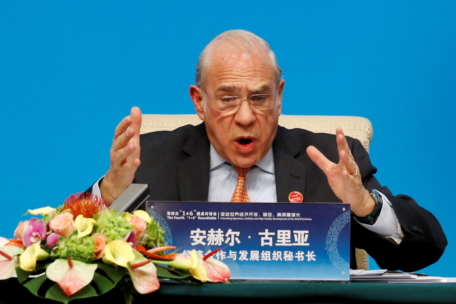 """FILE PHOTO: OECD Secretary-General Angel Gurria speaks at a news conference following the """"1+6"""" Roundtable meeting at the Diaoyutai state guesthouse in Beijing"""