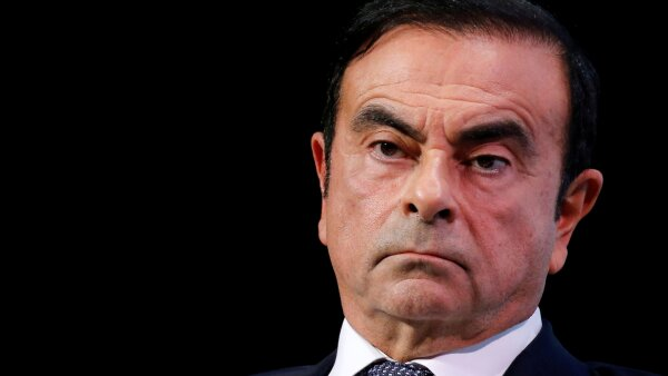 FILE PHOTO - Carlos Ghosn, chairman and CEO of the Renault-Nissan-Mitsubishi Alliance, attends the Tomorrow In Motion event on the eve of press day at the Paris Auto Show, in Paris