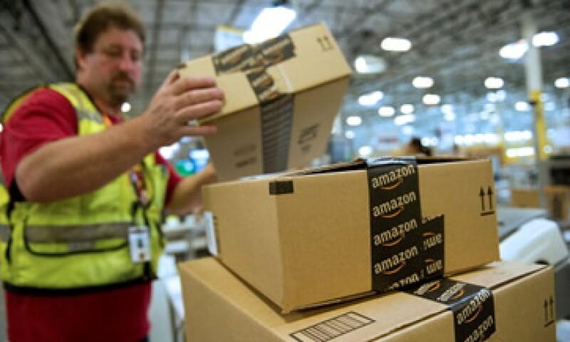 Amazon está gastando millones de dólares para expandirse, lo que ha tenido un impacto en sus ganancias. (Foto: AP)