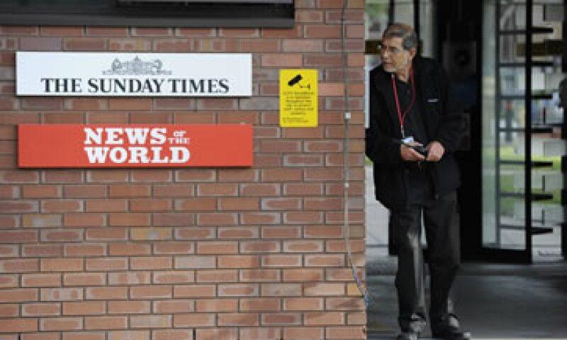 News of the World, comprado por Murdoch en 1969, fue el primer periódico que adquirió el magnate en Gran Bretaña.  (Foto: Reuters)