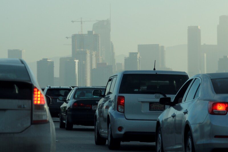 FILE PHOTO: FILE PHOTO: Commuters navigate early morning traffic as they drive toward downtown in Los Angeles, California