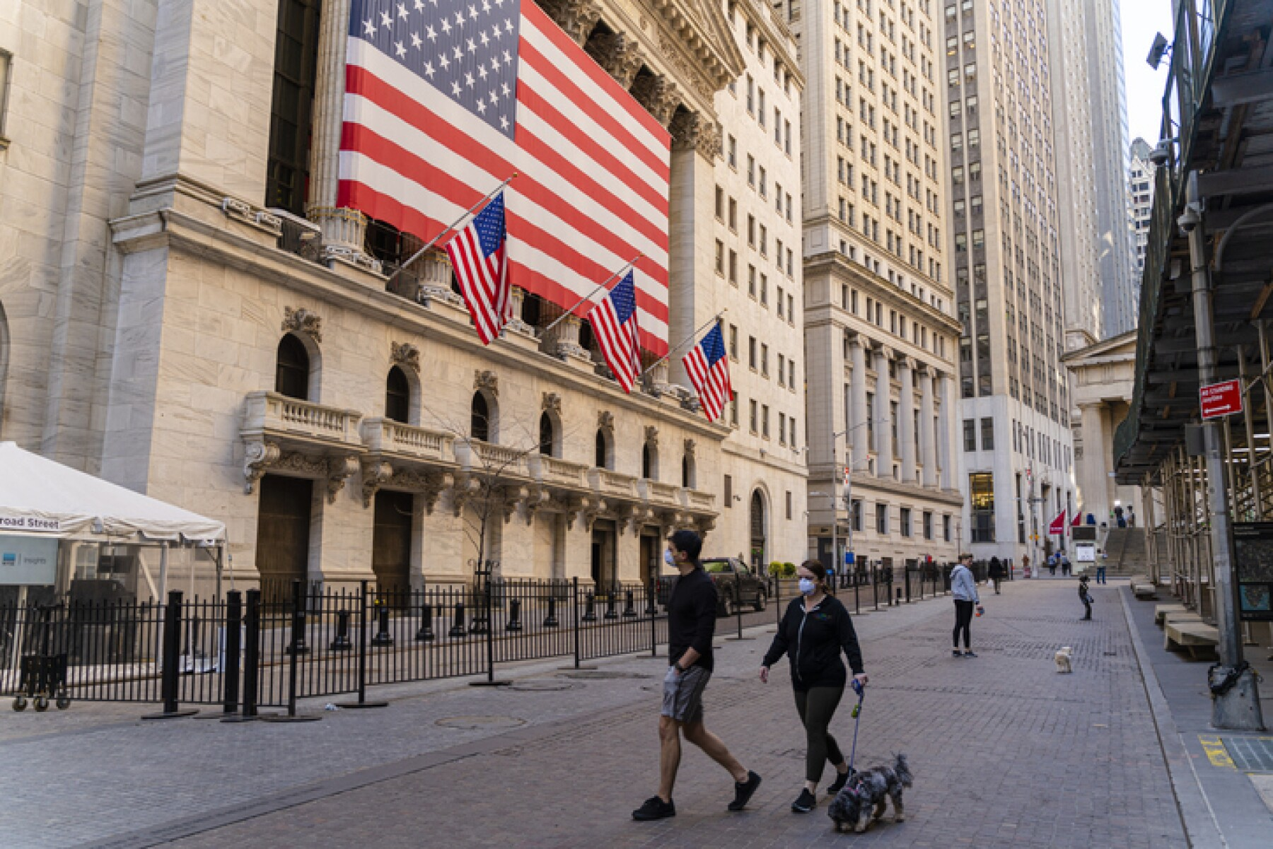 Economic recession is coming. 'Fearless Girl' Statue in front of the Stock Exchange from the Wall Street deserted because of the COVID-19 pandemic.