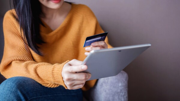 Happy Woman Customer using Credit Card and Tablet to Shopping Online. Selective focus