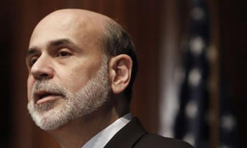 La entidad comandada por Ben Bernanke dijo que la economía de EU ha perdido fuerza. (Foto: AP)