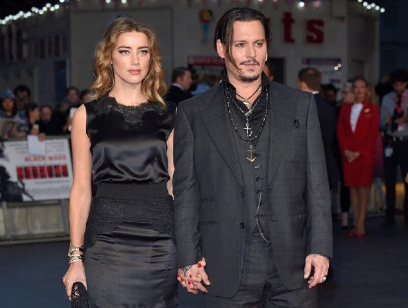 Amber se enamoró perdidamente de Johnny Depp, con quien se casó y además le lleva 22 años.